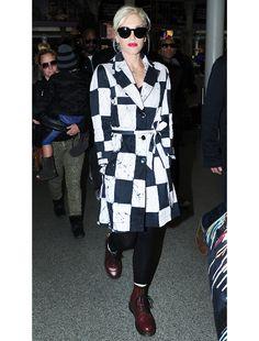 Gwen Stefani:  Kelly Wearstler Noir Cube Batik Trench. Dr. Marten Vintage 1490 Boots
