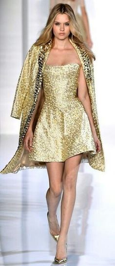 Strapless gold drees n overcoat