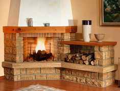 A brick fireplace is one of those cozy home features many folks covet. Corner Stone Fireplace, Fake Fireplace, Living Room With Fireplace, Fireplace Design, Fireplace Mantels, Cabin Homes, Cottage Homes, Elegant Living Room, Cozy House