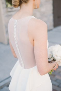 Sheer button-back peplum wedding dress: http://www.stylemepretty.com/2016/02/17/modern-wedding-dresses/