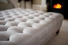 Image result for ottomans These are a great alternative to coffee tables as more comfy to put feet up on! they always look great with a few symmetrically placed piles of coffee table books.