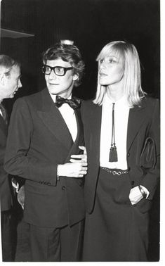 Yves St. Laurent with his muse Betty Catroux. A total style icon.