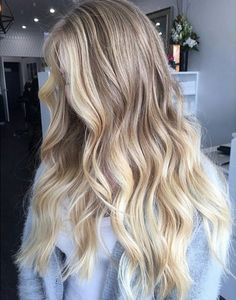 natural medium/light blonde hair with very light blonde highlights, face frame and tips