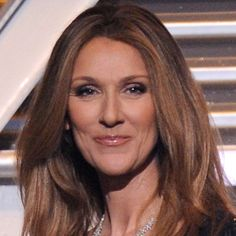 """French-Canadian singer Celine Dion dominated the pop charts in the with No. 1 hits like """"The Power of Love"""" and """"Because You Loved Me. Celine Dion Biography, Love People, Beautiful People, Famous Left Handed People, Unexpected Relationships, Pop Charts, Brown To Blonde, Great Women, Perms"""