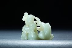 """CHINESE JADE CARVING OF A MONK.   Eighteenth-19th century. Openwork carving of a seated figure holding a stick in front of a large peach blossom tree. 2.75""""h.  Estimate $2,500-3,500 garths.com"""