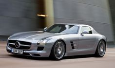 A Mercedes Benz SLS AMG. With a 6.2 Litre V8 engine, the SLS is the successor to the McLaren SLR as Mercedes GT roadster. All for $199,000!!!!!!