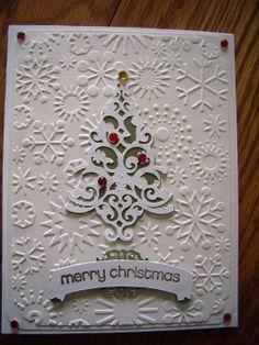 Used Cuttlebug snowflakes embossing folder and Trim the Tree Cricut cartridge.
