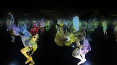 teamlab projects a maze of dancing japanese holograms - designboom | architecture & design magazine
