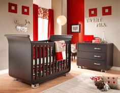 Sweet pea nursery - Khaki walls, red accents, and espresso colored furniture