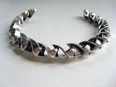 Silver Barbie shoe bracelet.... want!!! by Margaux Lange