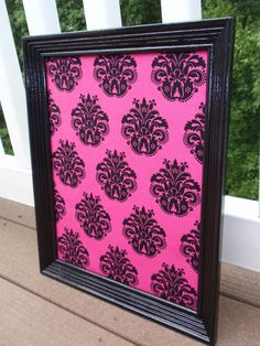 Framed Magnet Bulletin Board / Magnetic Makeup Board with Hot Pink & Black Damask Fabric in Black Glossy Frame with Five Jewel Magnets. $28.00, via Etsy.