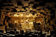 In his installation BOOMBOX, French designer Stéphane Malka sought to contrast the instability and transience inherent in cardboard boxes with the solidity and permanence of urban stone blocks, the major component of old buildings in Barcelona, the site of the installation.