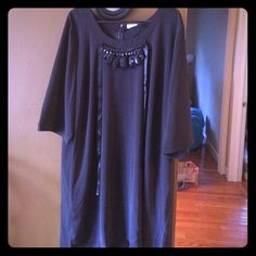 Black Oversized Dress  NWT!! This black oversized dress is great to wear with skinny jeans, leggings, or as a dress! It has an attached beaded necklace that ties around the neck. The dress is 100% polyester!  Junarose Dresses
