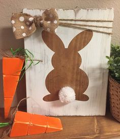 Easter is just around the corner and how cute would this bunny sign look hanging in your home to complete your Easter or spring decor! This adorable bunny has a white fuzzy Pom Pom tail and finished off with a burlap/white polka dot bow. Neutral colors Perfect to display with your