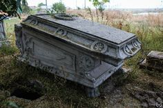 Empty sarcophagus outside the abandoned orthodox church outside of Bucharest, Romania. It's rumored that a strigori (a Romanian monster from folklore) lives in the churchyard. Cemetery Statues, Cemetery Headstones, Old Cemeteries, Cemetery Art, Angel Statues, Graveyards, Abandoned Churches, Abandoned Mansions, Abandoned Places
