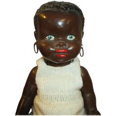 Today we are offering this beautiful and scarce Black doll. He is adorable and has the most beautiful face. She is 14 inches and is unmarked. He is
