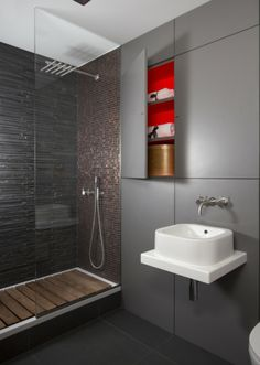 Amberth Interiors stunning designer bathroom with a touch of bold colour for that extra special feel