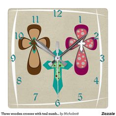 Three wooden crosses with teal numbers square wall clock