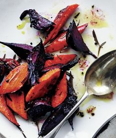 Rosemary-roasted beets and carrots from Real Simple. This side dish couldn't be easier—just toss all the ingredients together on a baking sheet and roast until tender.