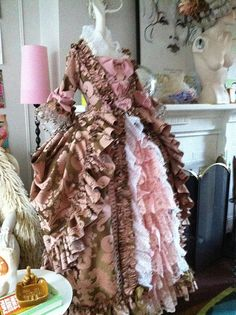 """This has been repinned a lot.  It's not a real """"Marie Antoinette Dress"""" and, I admit, it drives me batty to see people pinning it to Historical categories.   It's a costume and to those that study fashion, it's very clearly a costume.   The lacy front of the petticoat is pretty, but nothing close to that exists in the 18th C.  The pink & brown fabric is cute but it's very modern looking.  It's a cute dress & would a great costume but, please stop pinning this under """"18th Century""""."""