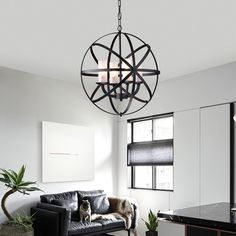 Unique and engaging, this chandelier will add a dash of urban appeal to your room. The globe chandelier is crafted from crossing bands of metal. Four candle-like lights rest inside the globe.