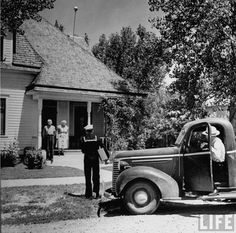 A Sailor Arriving Home on Leave Greeting His Grandparents 1942