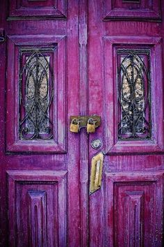 What an astounding array of colors -- from violet to rose and even deep purple. Aren't the leaded glass windows beautiful? I wonder why the doors have padlocks on them. The windows have an arched design. Cool Doors, The Doors, Unique Doors, Windows And Doors, Front Doors, Entry Doors, Purple Door, Purple Haze, Shades Of Purple