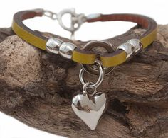 Green leather bracelet with silver look heart £19.95