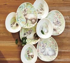 Egg-shaped bunny plates & bowls from Pottery Barn.  $39.50 for a set of four.  Four different designs per set.