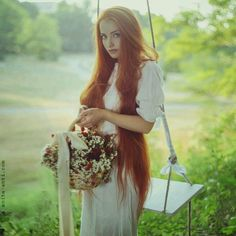 very very long red hair..pretty @ Tina this is the color I like :)