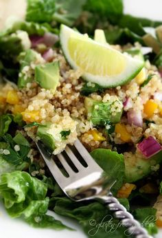 Quinoa taco salad with avocado and lime- perfect for a gluten-free diet.  Maybe add some chili powder to the seasonings and I would add beans (cause I like em)