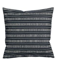Cushion cover in woven cotton fabric with a printed motif. Concealed zip at back. Size 20 x 20 in.