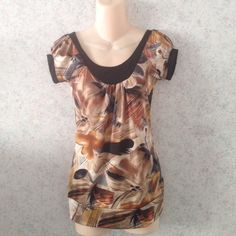 """Spring/Summer Blouse ♦️Price Firm, No Offers♦️  Brand New. Boutique brand.  Colors: Brown + tan/gold +Black -92% Polyester + 8% Spandex  -Says size Large but fits like a Medium (runs a size small) -Measurements laying flat (left to right): Chest: 14.5"""" Waist: 14"""" Hollow to Hem (from top to bottom):  26"""" - Will ship ASAP❤️ I also do bundles. 15% off on 2 or more items from my closet. Just use the bundle button Boutique Tops Blouses"""