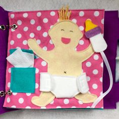 Diaper the Baby - a single page to add to your custom book! The perfect page for a new big brother or sister. Have fun pretending and playing changing babys diaper. Open and close the diaper and use the wipes- and feed baby a bottle! Diaper fastens with Velcro and bottle attaches to page with Velcro. Quiet Books are a great way to keep your little ones occupied and learning during church, doctors appointments, traveling, or anywhere you need to keep your children quietly entertained! Unique…