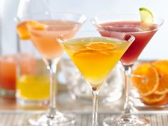 Skinny Clementine Martini made with gin or citrus vodka, elderflower liqueur, lime juice, club soda and a garnish of your choice.
