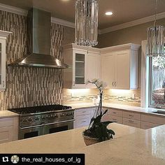 Backsplash inspiration. Love how the tile was turned vertical behind the stove and range hood.  Repost @the_real_houses_of_ig