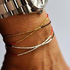 Delicate Gold on black silk bracelet