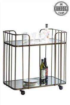 Buy Verna Drinks Trolley By Hudson Living from the Next UK online shop Bar Trolley, Drinks Trolley, Bar Carts, Design Seeds, Serving Cart, Interiors Online, Kitchen Cart, Glass Shelves, Bronze Finish