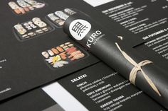 DESIGNED BY ARTENTIKO.  White on black is like white on rice in Artentiko's high contrast, hand-rolled menu for Polish sushi restaurant Kuro.