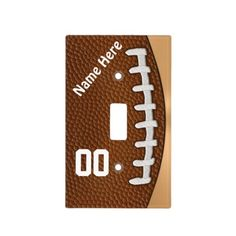 Personalized Football Light Switch Covers. Many matching Football Accessories for Bedroom. Cool golden background really sets off the close up Football with faux texture.  http://www.Zazzle.com/LittleLindaPinda*  Call Linda for Help or to Change any of our Designs: 239-949-9090