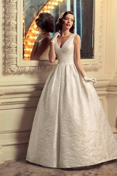 Tatiana Kaplun Bridal Collection 2015 | Gorgeous Sleeveless A-Line Wedding Gown Featuring A Low Cut V Neckline, Fitted Bodice, & Full, Box Pleated A-Line Skirt××××