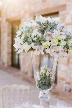 Ethereal wedding centerpiece - giant glass pedestal vase filled with cymbidium orchids, roses, and dusty miller. Beach Wedding Bouquets, Beach Theme Wedding Invitations, Beach Wedding Centerpieces, Wedding Flower Arrangements, Flower Centerpieces, Wedding Decorations, Floral Arrangements, Botanical Wedding, Floral Wedding