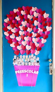 "Valentine's day classroom doors: ""Preescolar"" Air balloon, heart shaped balloons, students photos in air balloon day decorations for classroom door 31 Adorable Valentine's Day Doors for Your Classroom Class Decoration, School Decorations, Valentine Decorations, Valentine Day Crafts, Valentines Day Decor Classroom, Valentines Design, Preschool Door, Preschool Activities, San Valentin Ideas"