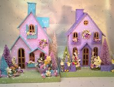 Charming Lavender Spring Cottage (Large) Gltterhouse.This listing is for the house and items listed below only, not any background items. Sweet Putz Spring Cottage is ready for your home with all its cheery flowers.The window boxes are brimming with Spring blooms. A yellow fuzzy