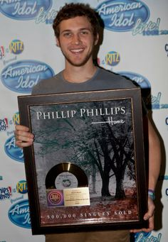 Phillip Phillips and his first Gold Record. Couldn't be more proud of my boy! <3
