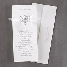 Shimmering Snowflake - Winter Weddings Invitation A shimmering snowflake design with a sheer ribbon shown underneath is displayed on this invitation.