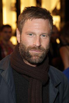 Aaron Eckhart, I found him extreamly attractive in Erin Brockovich...
