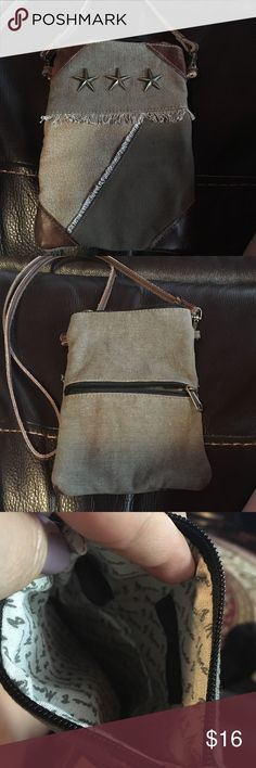 Casual Crossbody purse Canvas purse with leather trim.  Roomy interior, will hold phone, keys, billfold, etc easily!  Even has real handy zippered compartment on the back for easy access.  Never used, perfect condition.  NWOT Mona B Bags Crossbody Bags