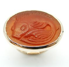 Hand-carved Carnelian Koi-fish cameo set in a red gold ring.