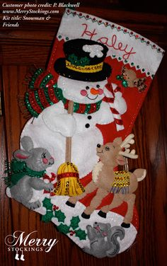 Customer photo of completed kit sent to MerryStockings. Kit entitled Snowman and Friends by Bucilla.